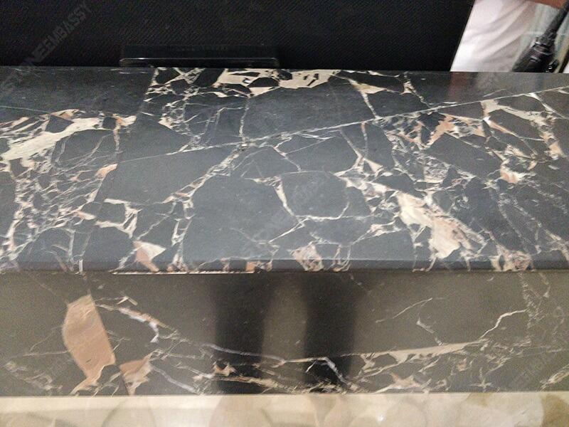 athens black gold marble honed reception desk