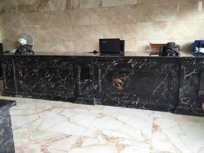 athens black gold marble reception desk