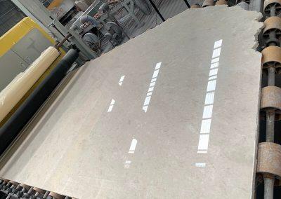 empire beige marble in polishing machine