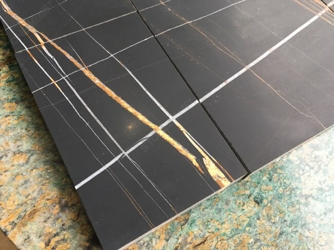 honed sahara noir tile