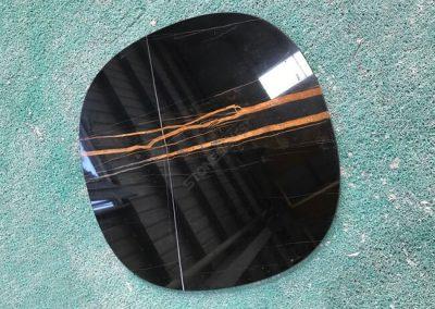 polished sahara noir marble table top