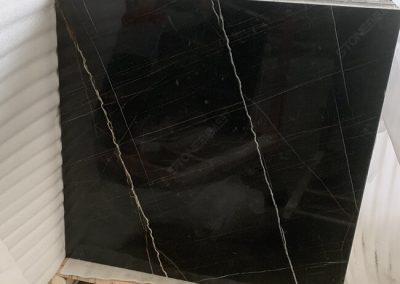 polished sahara noir marble tile